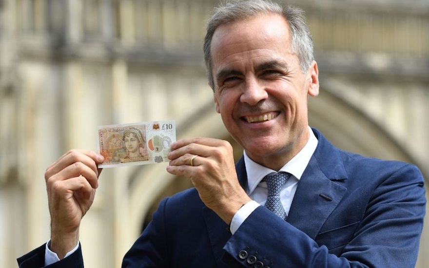 Mark Carney with new 10 pound note outside Winchester Cathedral